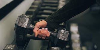 woman weightlifting eating disorder recovery