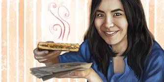 Lynn Chen holding a sandwich