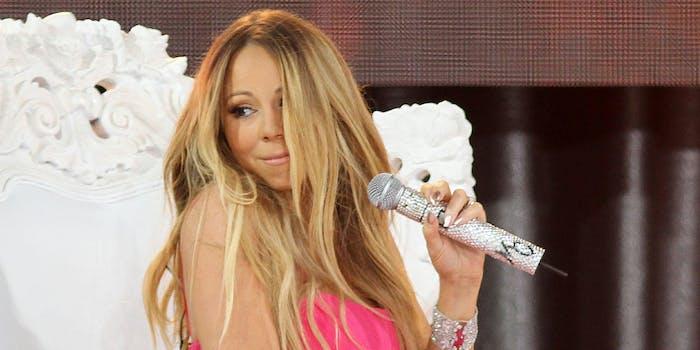 Mariah Carey holding wireless microphone