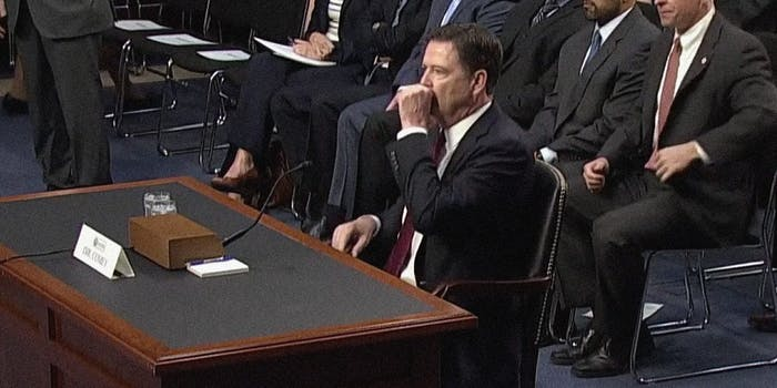 James Comey with Hand Over Mouth