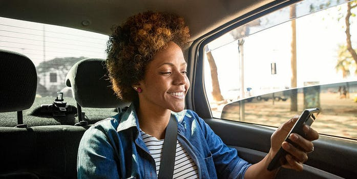 Woman in Uber smiling