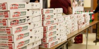 Boxes of Papa John's pizza