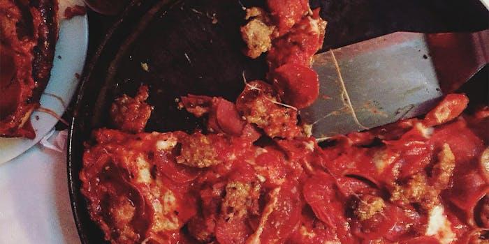 Deep dish pepperoni pizza with metal spatula