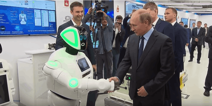 vladimir putin shakes hand with promobot robot