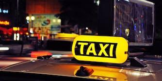 A taxi cab sign lit up
