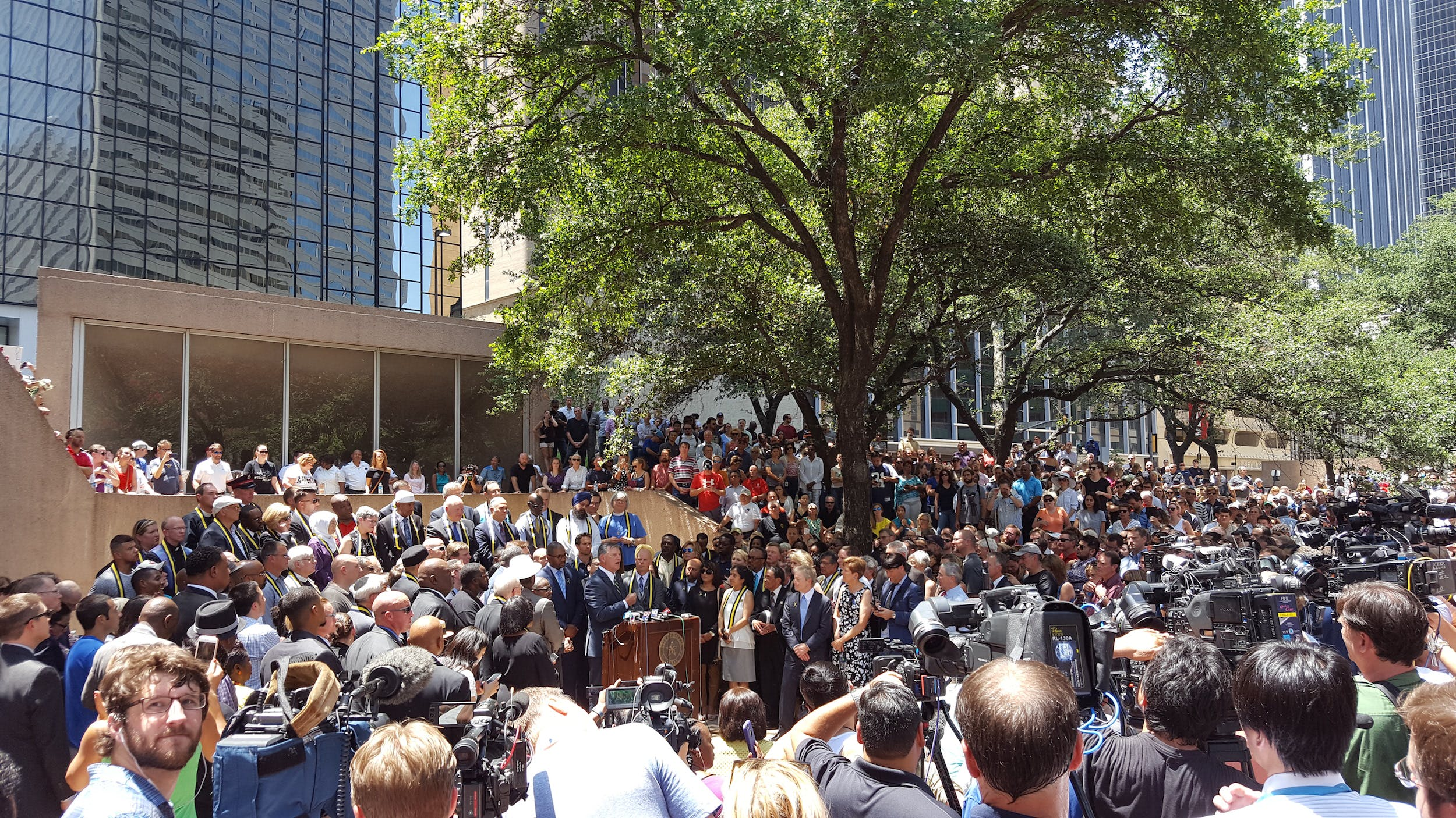 Dallas Mayor Mike Rawlings joined by faith leaders of the Dallas community at Thanks-Giving Square on July 8, 2016.