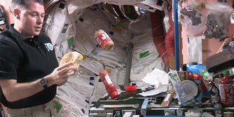 Astronaut making peanut butter and jelly sandwich in space