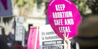 Safe and legal abortion signs at the Women's March in Los Angeles