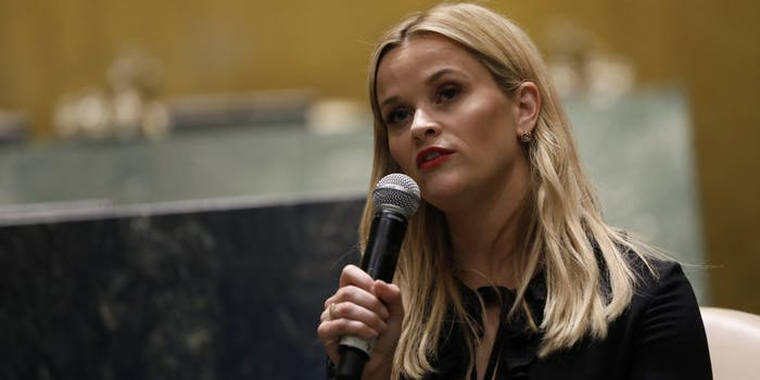 Reese Witherspoon holds a microphone while giving a speech at the UN