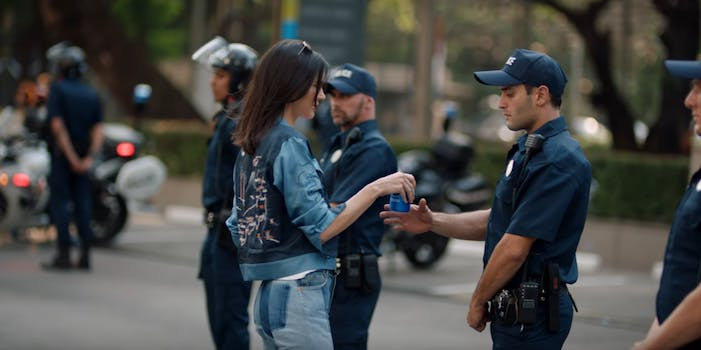Jenner gives cop a pepsi