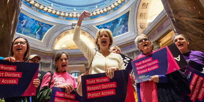 """""""Trust Women. Respect Doctors. Protect Access, Stand up Fight Back"""" rally at the Minnesota state capitol rotunda"""