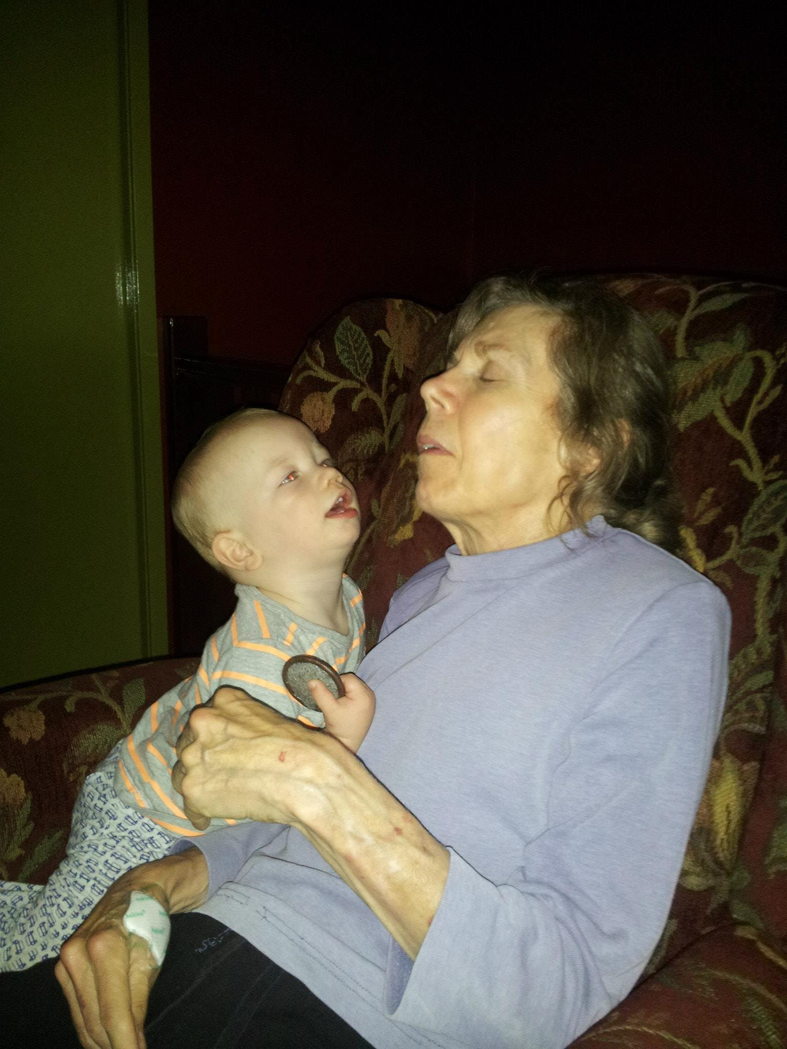"""""""Cuddles with her 14 month old grandson. He's very careful with her, knows she's special."""""""