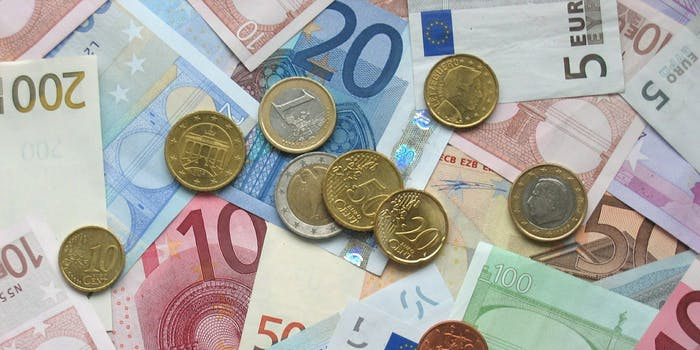 Euro coins and banknotes in a pile.