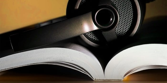 what is audible : Headphones holding open a book
