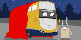 Cartoon depicting a Dublin bus with a blanket and hot coco