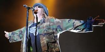 Kid Rock sings in an army jacket.