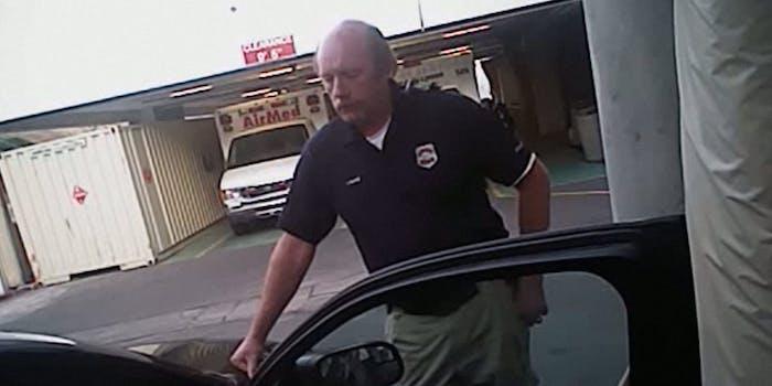 Disgraced Utah police officer leans on hood of squad car