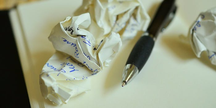 Crumpled up paper while writing letters.