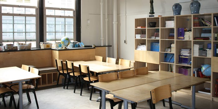 A school classroom full of empty desks.