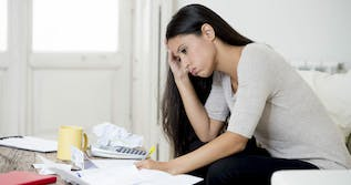 woman taxes paperwork frustrated tax bill