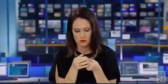 newscaster daydream on live television: picture of newscaster staring at her pen