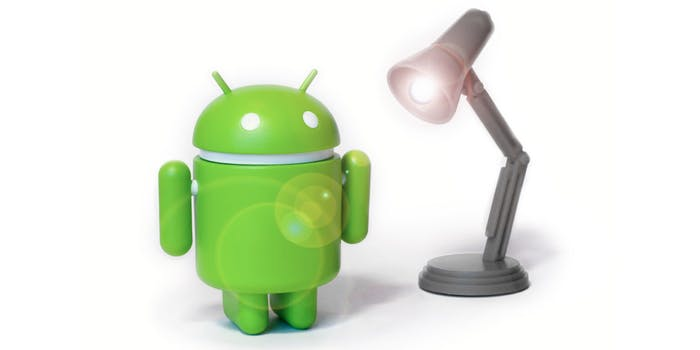 Android figurine next to lamp