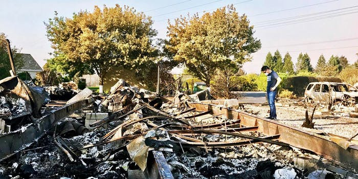 Kevin Kwan Loucks looks at the devastation wrought to his family's home as a result of the wildfires in California.