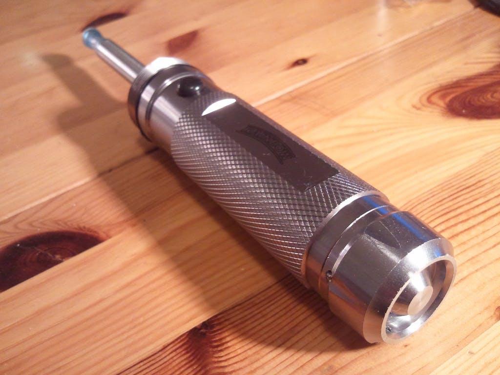 A modified flashlight e-cig