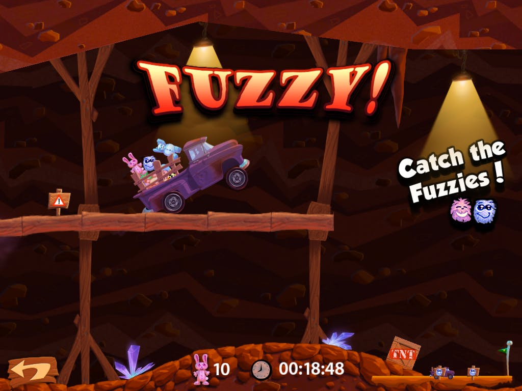 A picture of a cartoon truck, filled with brightly-colored stuffed animals, driving through a cave.