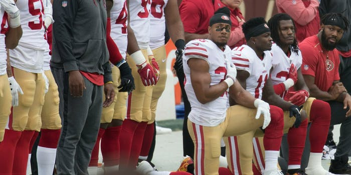 Some members of the San Francisco 49ers kneel during the National Anthem before a game against the Washington Redskins at FedEx Field on October 15, 2017 in Landover, Maryland.