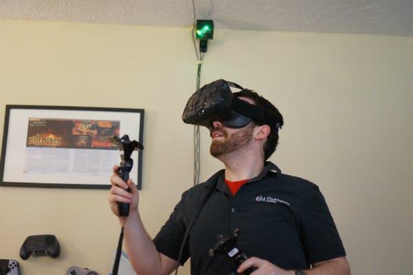 Alex Schwartz, wearing a development version of the HTC Vive virtual reality hardware.