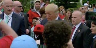 donald trump signs a hat