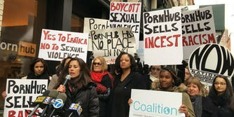 Protesters, including Gloria Steinem, rally against PornHub's popup store in SoHo, New York.