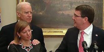Joe Biden with his hands on Stephanie Carter's shoulders