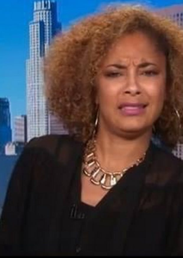 Amanda Seales contorting her mouth