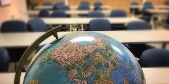 Globe in empty classroom