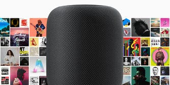 Black HomePod with album covers behind