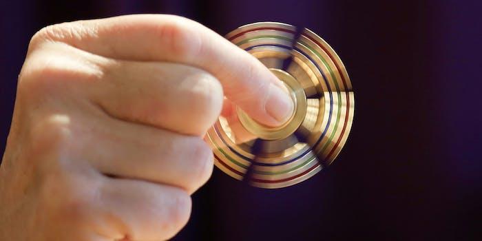 Man holding fidget spinner toy