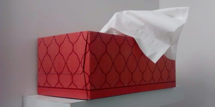 Red tissue box on shelf