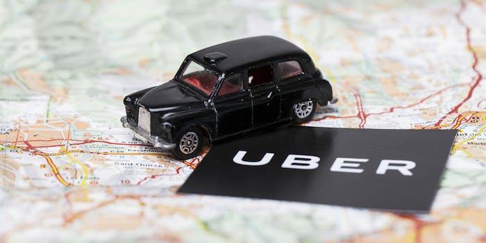 uber logo on map with london black cab