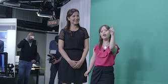 21-year-old Melanie Segard stands next to a green screen as she fulfills her lifelong dream of presenting the weather on television.