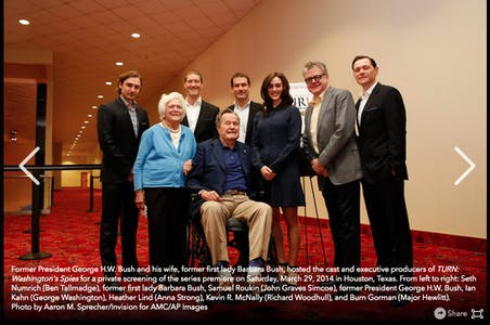 A photo of George HW Bush, Barbara Bush, and the cast and producers of Turn: Washington's Spies