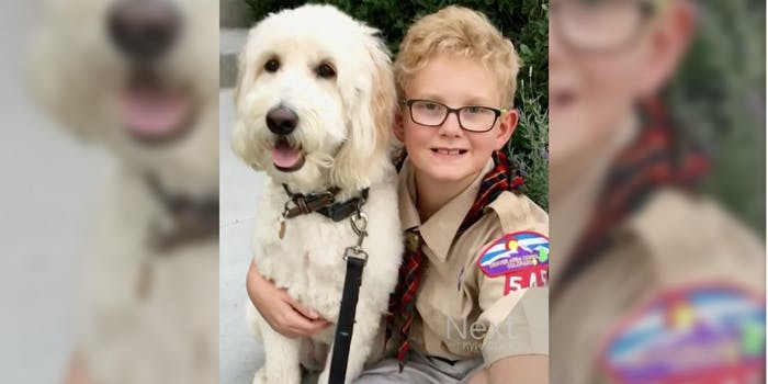 Colorado-based Cub Scout Ames Mayfield and his dog