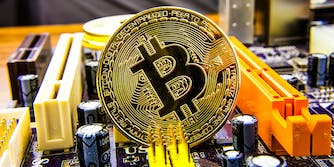 Bitcoin sitting on motherboard