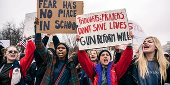 Teenage women protest for gun control reform in front of the White House.