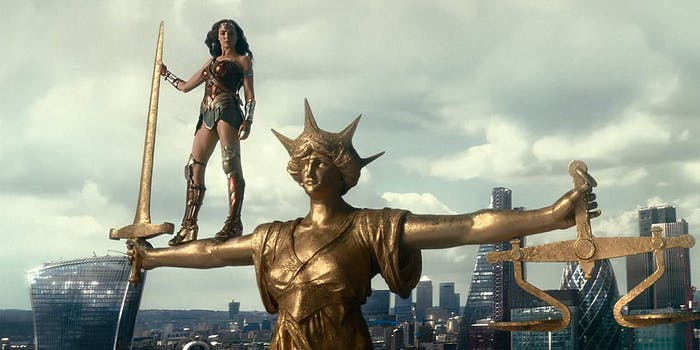 Wonder Woman standing on gold statue
