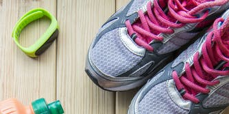 How many steps should you walk a day : Fitbit tracker and running shoes
