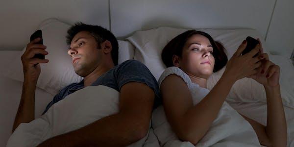 benefits of porn : couple using smartphones