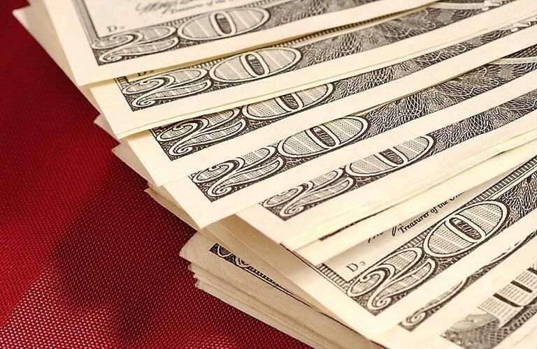 Stack of twenty dollar bills fanned out