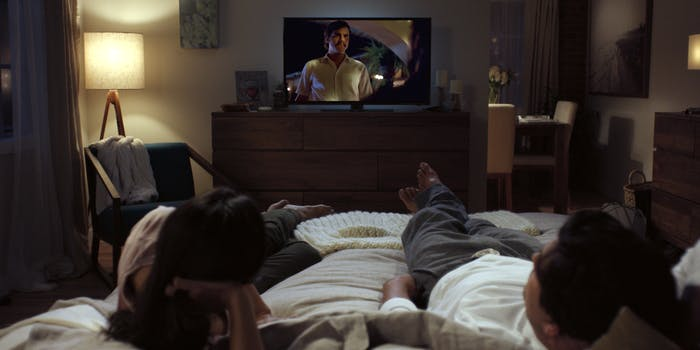 Netflix viewers in bed watching Narcos
